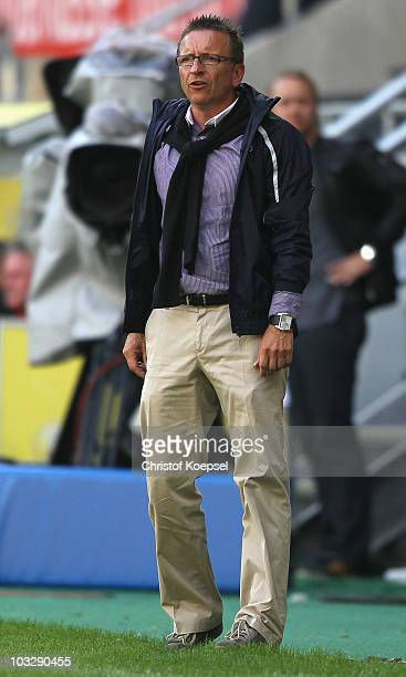 Head coach Norbert Meier of Duesseldorf looks thoughtful during the Derby Cup 2010 match between Bayer Leverkusen and Fortuna Duesseldorf at the...
