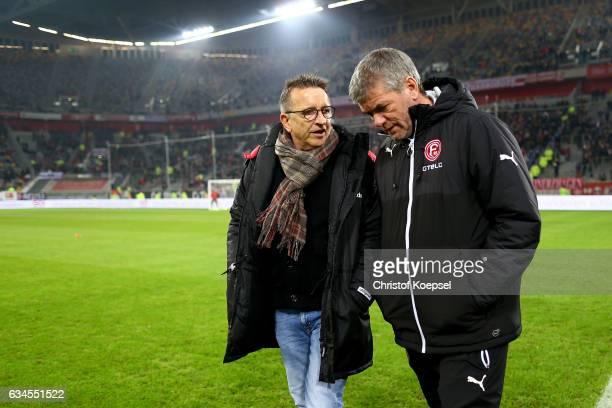Head coach Norbert Meier of Kaiserslautern and head coch Friedhelm Funkel of Duesseldorf talk prior to the Second Bundesliga match between Fortuna...