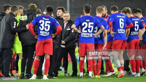 Head coach Norbert Meier of Uerdingen walks past his players after losing the 3 Liga match between KFC Uerdingen 05 and Karlsruher SC at...