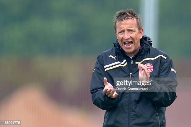 Head coach Norbert Meier reacts during a Fortuna Duesseldorf training session at Arena Sport Park on May 8 2013 in Duesseldorf Germany