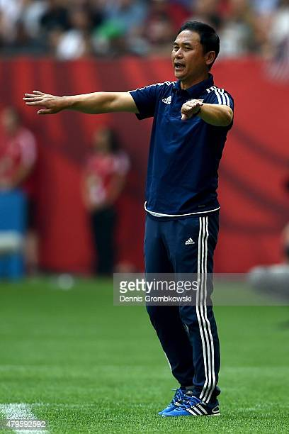 Head coach Norio Sasaki of Japan calls out in the first half while taking on the United States in the FIFA Women's World Cup Canada 2015 Final at BC...