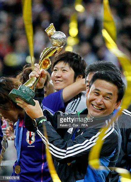 Head coach Norio Sasaki of Japan celebrates after defeating USA for the FIFA Women's World Cup Final match between Japan and USA at the FIFA World...