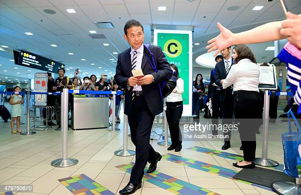 Head coach Norio Sasaki of Japan is seen on departure at Vancouver International Airport on July 6, 2015 in Vancouver, Canada.