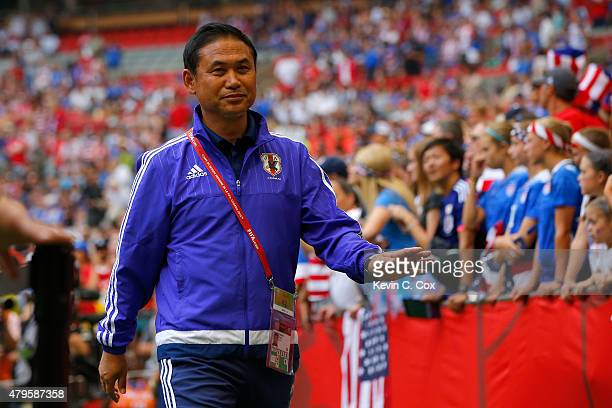 Head coach Norio Sasaki of Japan walks out to the pitch to take on the United States in the FIFA Women's World Cup Canada 2015 Final at BC Place...