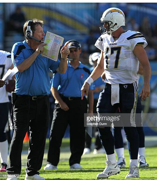 Head coach Norv Turner of the San Diego Chargers confers with quarterback Philip Rivers during the game with the Miami Dolphins at Qualcomm Stadium...