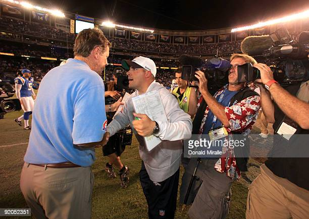 Head Coach Norv Turner of the San Diego Chargers shakes the hand of Head Coach Josh McDaniels of the Denver Broncos after the Broncos' 3423 win...