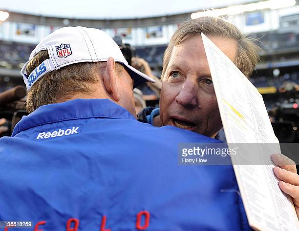 Head coach Norv Turner of the San Diego Chargers talk with Head coach Chan Gailey of the Buffalo Bills after the game at Qualcomm Stadium on December...