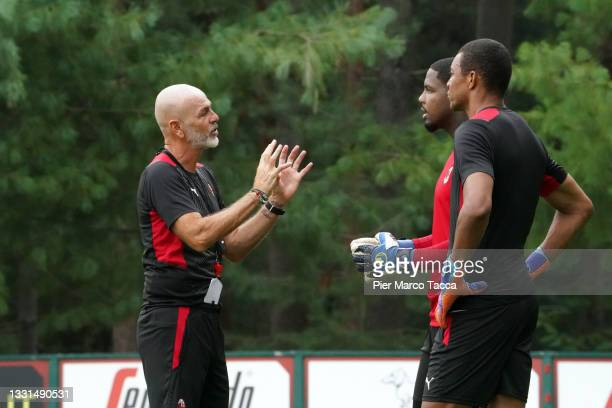Head Coach of AC Milan Stefano Pioli speaks with Goalkeeper of AC Milan Mike Maignan and Nelson Dida during an AC Milan Training Session at Milanello...