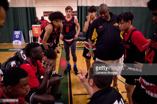 Head Coach of Alaska Tru Game huddles the team up during the game against Seattle Rotary during the Jr NBA World Championship Northwest Regional...