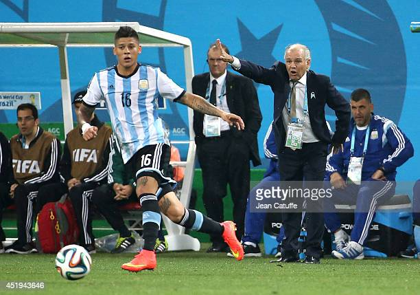 Head coach of Argentina Alejandro Sabella gestures watching Marcos Rojo of Argentina in action during the 2014 FIFA World Cup Brazil Semi Final match...