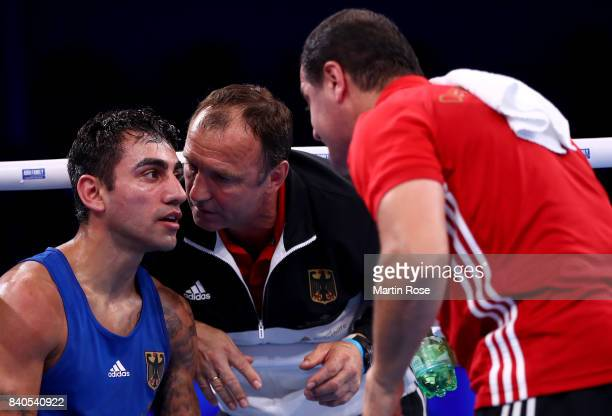Head coach of Artem Harytyunyan Michael Timm and assistant coach Arthur Grigorian look dejected after the Men's light welter during the quarter...