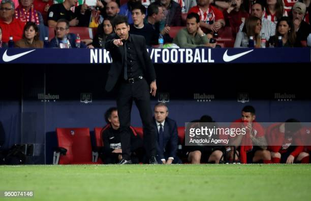Head coach of Atletico Madrid Diego Simeone gives tactics to his players during the La Liga soccer match between Atletico Madrid and Real Betis at...