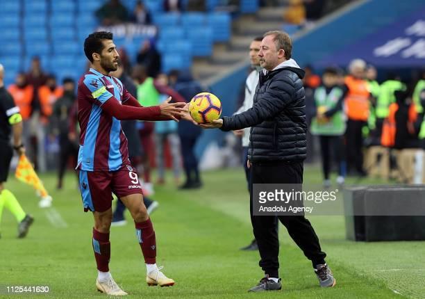 Head coach of Aytemiz Alanyaspor Sergen Yalcin gives the ball to Trabzonspor's Vahid Amiri during Turkish Super Lig week 22 soccer match between...