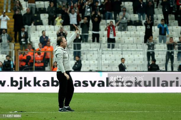 Head coach of Aytemiz Alanyaspor Sergen Yalcin greets Besiktas' fans after he was invited to the pitch by them at the end of the Turkish Super Lig...
