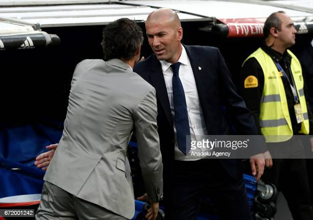Head Coach of Barcelona Luis Enrique shakes hands with Head Coach of Real Madrid Zinedine Zidane ahead of the La Liga match between Real Madrid and...