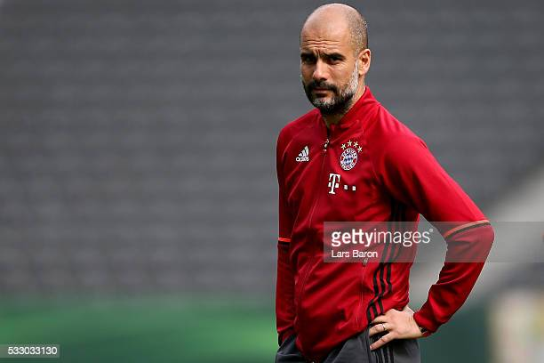 Head coach of Bayern Muenchen Josep Guardiola looks on during the Bayern Muenchen final training session ahead of the DFB Cup Final 2016 at...