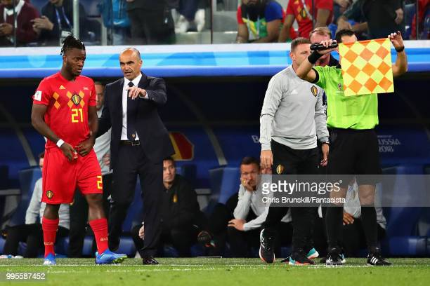Head Coach of Belgium Roberto Martinez talks with Michy Batshuayi of Belgium before introducing him as a substitute during the 2018 FIFA World Cup...