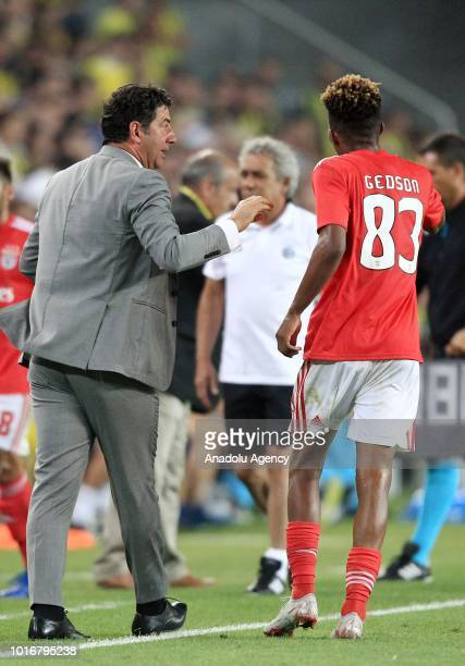 Head coach of Benfica Rui Vitoria gives tactics to his player Gedson Fernandes of Benfica during UEFA Champions League third qualifying round's...