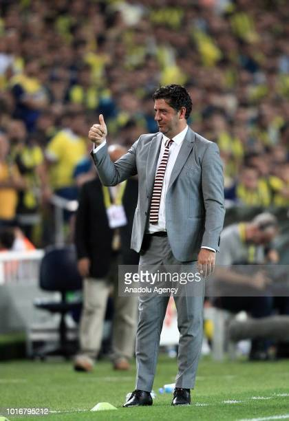 Head coach of Benfica Rui Vitoria greets the fans during UEFA Champions League third qualifying round's second leg match between Fenerbahce and...