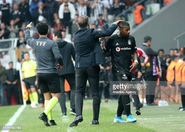 Head coach of Besiktas Abdullah Avci greets his player Lens during Turkish Super Lig soccer match between Besiktas and Aytemiz Alanyaspor at Vodafone...