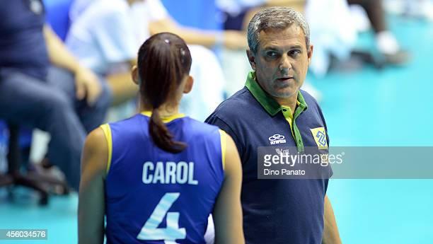 Head coach of Brazil Jose Roberto Lages Guimareas speaks with Ana Carolina Da Silva during the FIVB Women's World Championship pool B match between...