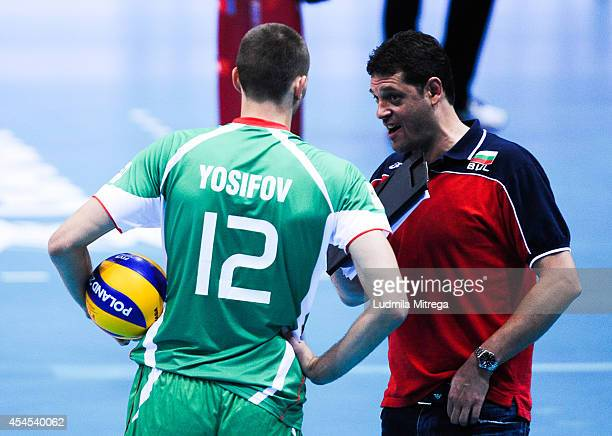 Head coach of Bulgaria Plamen Konstantinov speaks to his player Viktor Yosifov during the FIVB World Championships match between Bulgaria v Canada on...