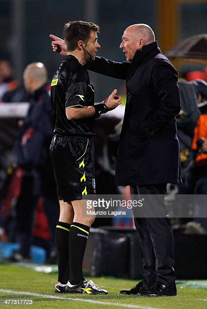 Head coach of Catania Roalndo Maran speaks with the referee Nicola Rizzoli during the Serie A match between Calcio Catania and Cagliari Calcio at...