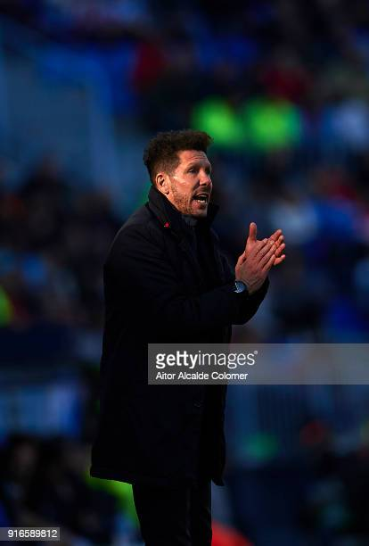 Head coach of Club Atletico de Madrid Diego Pablo Simeone looks on during the La Liga match between Malaga and Atletico Madrid at Estadio La Rosaleda...