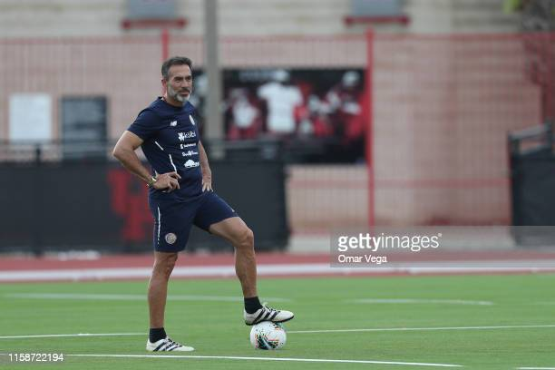 Head coach of Costa Rica Gustavo Matosas warms up during a training session ahead of the Gold Cup match against Mexico at University of Houston on...