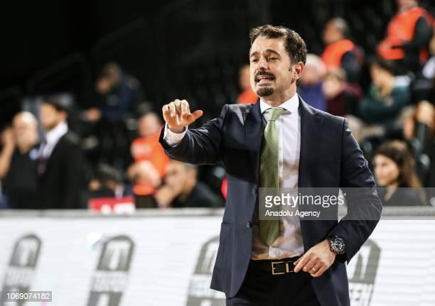 Head coach of Darussafaka Tekfen Ahmet Caki gives tactics to his players during a Turkish Airlines Euroleague basketball match between Darussafaka...