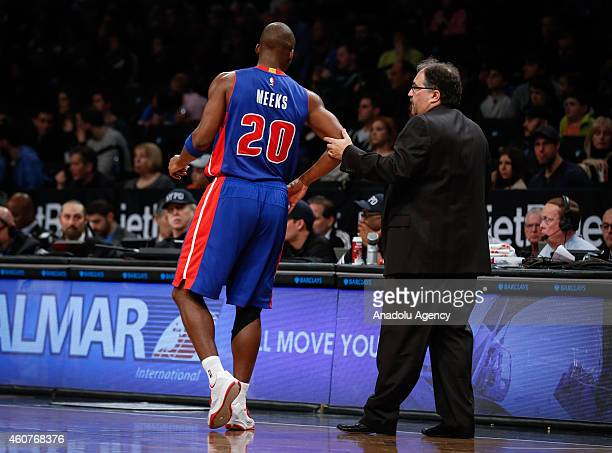 Head coach of Detroit Pistons Stan Van Gudy speaks with Jodie Meeks during NBA basketball game between Brooklyn Nets and Detroit Pistons at the...
