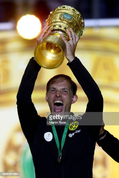 Head coach of Dortmund Thomas Tuchel lifts the trophy after winning the DFB Cup Final 2017 between Eintracht Frankfurt and Borussia Dortmund at...