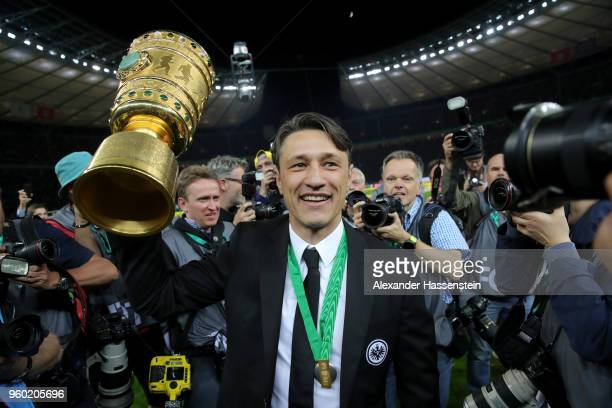 Head coach of Eintracht Frankfurt Niko Kovac lifts the DFB Cup trophy after winning the DFB Cup final against Bayern Muenchen at Olympiastadion on...