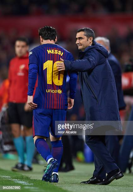 Head Coach of FC Barcelona Ernesto Valverde and Lionel Messi of FC Barcelona looks on during the La Liga match between Sevilla CF and FC Barcelona at...