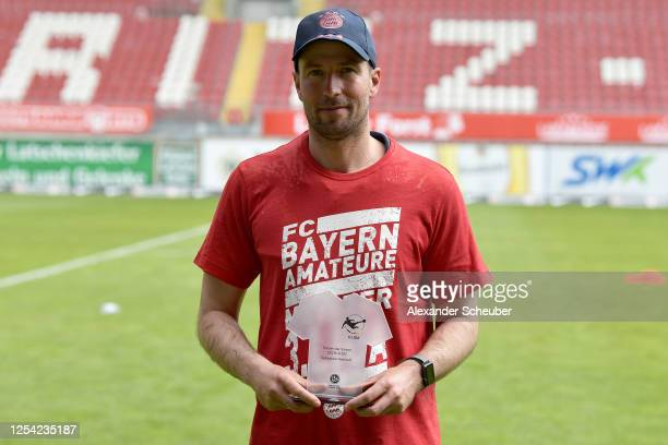 Head coach of FC Bayern Muenchen II Sebastian Hoeness is awarded with the trophy for the best head coach of the season after the 3. Liga match...