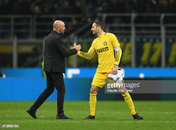 Head coach of FC Crotone Walter Zenga shakes hands with Samir Handanovic of FC Internazionale at the end the serie A match between FC Internazionale...