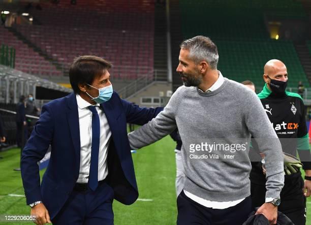 Head Coach of FC Internazionale Antonio Conte shakes hands with head coach of Borussia Moenchengladbach Marco Rose before the UEFA Champions League...