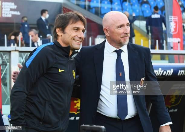 Head Coach of FC Internazionale Antonio Conte shakes hands with head coach of Genoa CFC Rolando Maran before the Serie A match between Genoa CFC and...