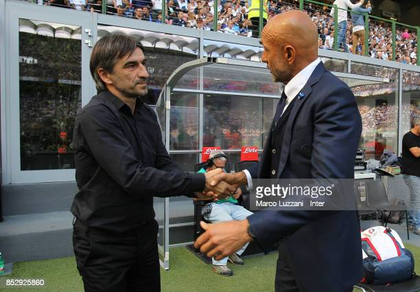 Head coach of FC Internazionale Luciano Spalletti shakes hands with head coach of Genoa CFC Ivan Juric looks before the Serie A match between FC...