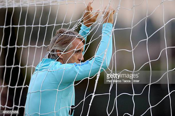 Head coach of FC Internazionale Roberto Mancini in action during the FC Internazionale training session at Appiano Gentile on September 22 2015 in...
