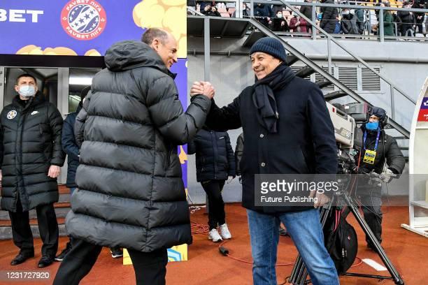 Head coach of FC Zorya Luhansk Viktor Skrypnyk shakes hands with head coach of FC Dynamo Kyiv Mircea Lucescu during the 2020/2021 Ukrainian Premier...