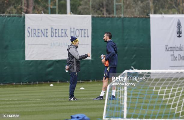 Head coach of Fenerbahce Aykut Kocaman talks to his player Mehmet Topal during a training session ahead of the 2nd half of Turkish Super Lig at Belek...