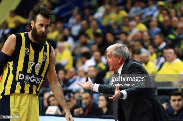 Head Coach of Fenerbahce Dogus Zeljko Obradovic talks with his player Luigi Datome during the Turkish Airlines Euroleague basketball match between...
