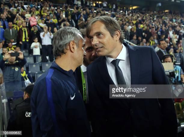 Head coach of Fenerbahce Phillip Cocu and head coach of MKE Ankaragucu Ismail Kartal are seen ahead of a Turkish Super Lig soccer match between...