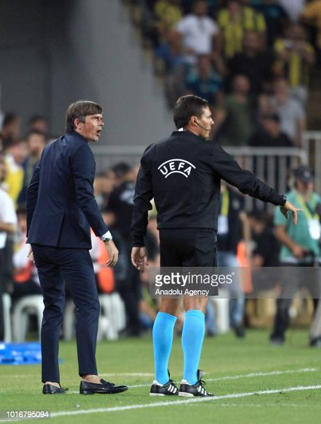 Head coach of Fenerbahce Phillip Cocu argues with the assistant referee during UEFA Champions League third qualifying round's second leg match...