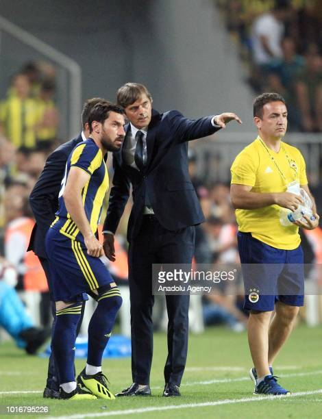 Head coach of Fenerbahce Phillip Cocu gives tactics to his player during UEFA Champions League third qualifying round's second leg match between...