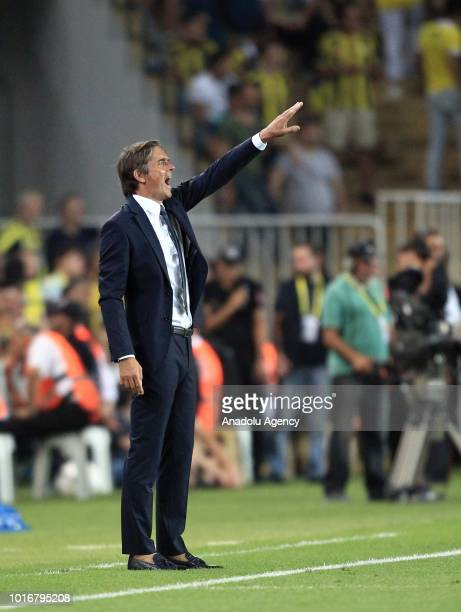 Head coach of Fenerbahce Phillip Cocu gives tactics to his players during UEFA Champions League third qualifying round's second leg match between...
