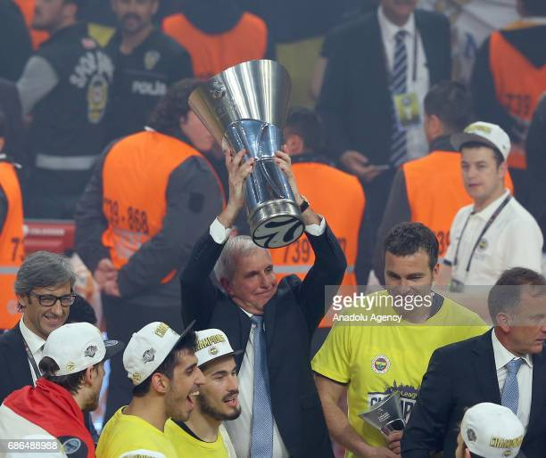 Head Coach of Fenerbahce Zeljko Obradovic celebrates their team's victory after players received the cup in Turkish Airlines Euroleague Final Four...