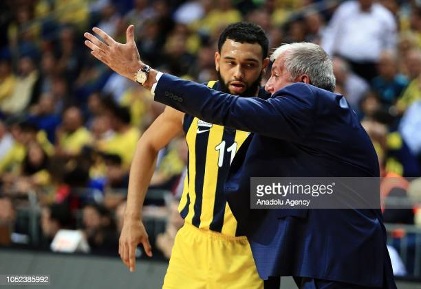 Head coach of Fenerbahce Zeljko Obradovic gives tactics to his player Tyler Ennis during the Turkish Airlines Euroleague basketball match between...