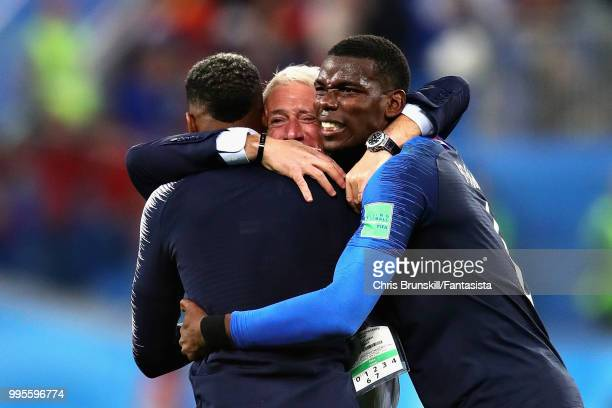 Head Coach of France Didier Deschamps celebrates with Paul Pogba and Presnel Kimpembe both of France after the 2018 FIFA World Cup Russia Semi Final...
